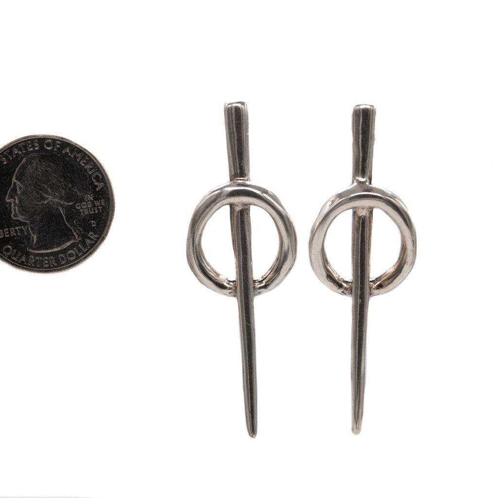 Backstitch earring Uno de 50