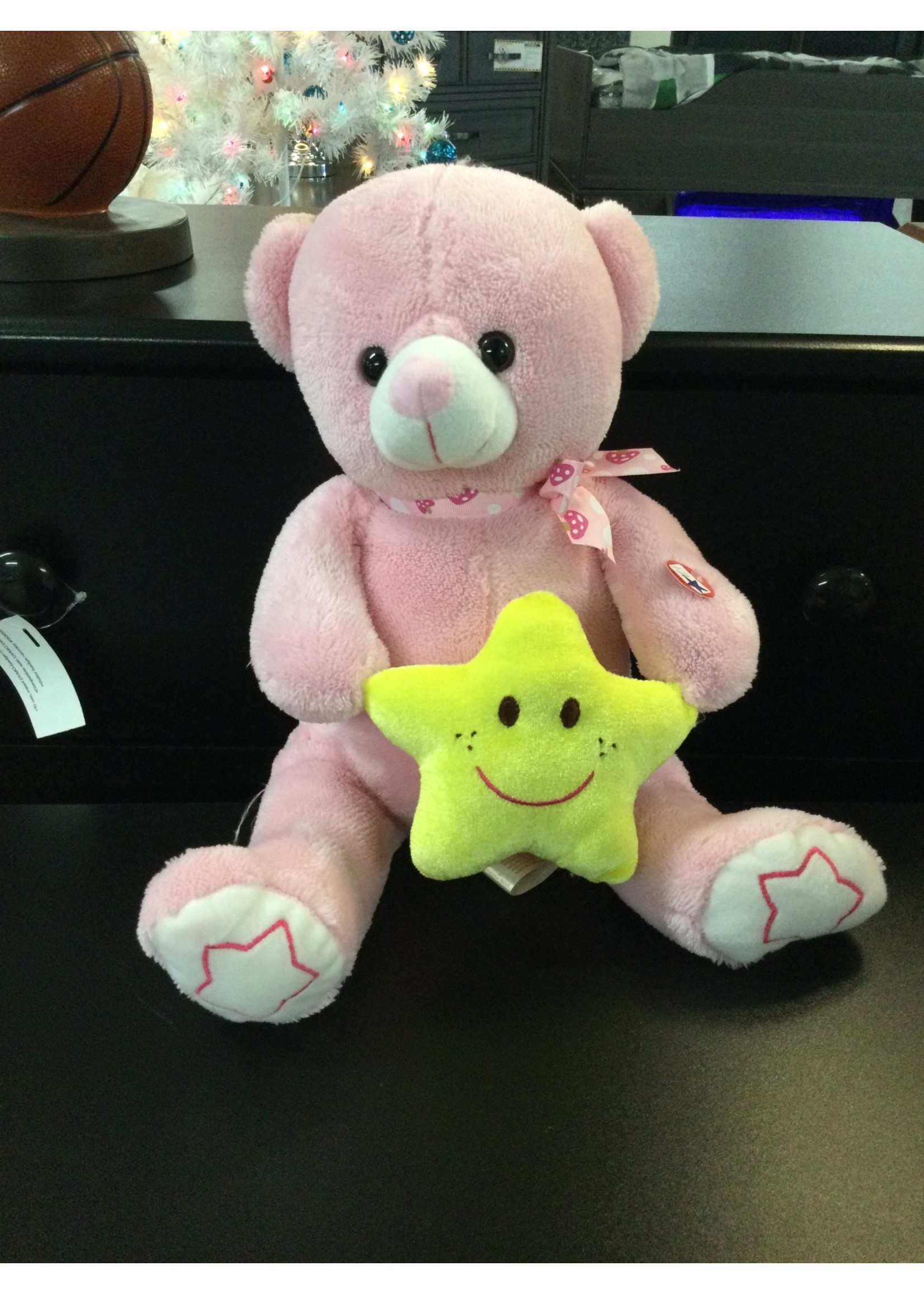 Pink bear with star
