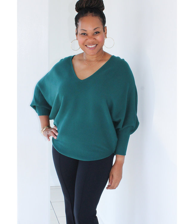 This is a must have in all the colors!  The v neck and the adorable fit are a fave!  Love that the sleeves can be pushed up or left down for a completely different look!