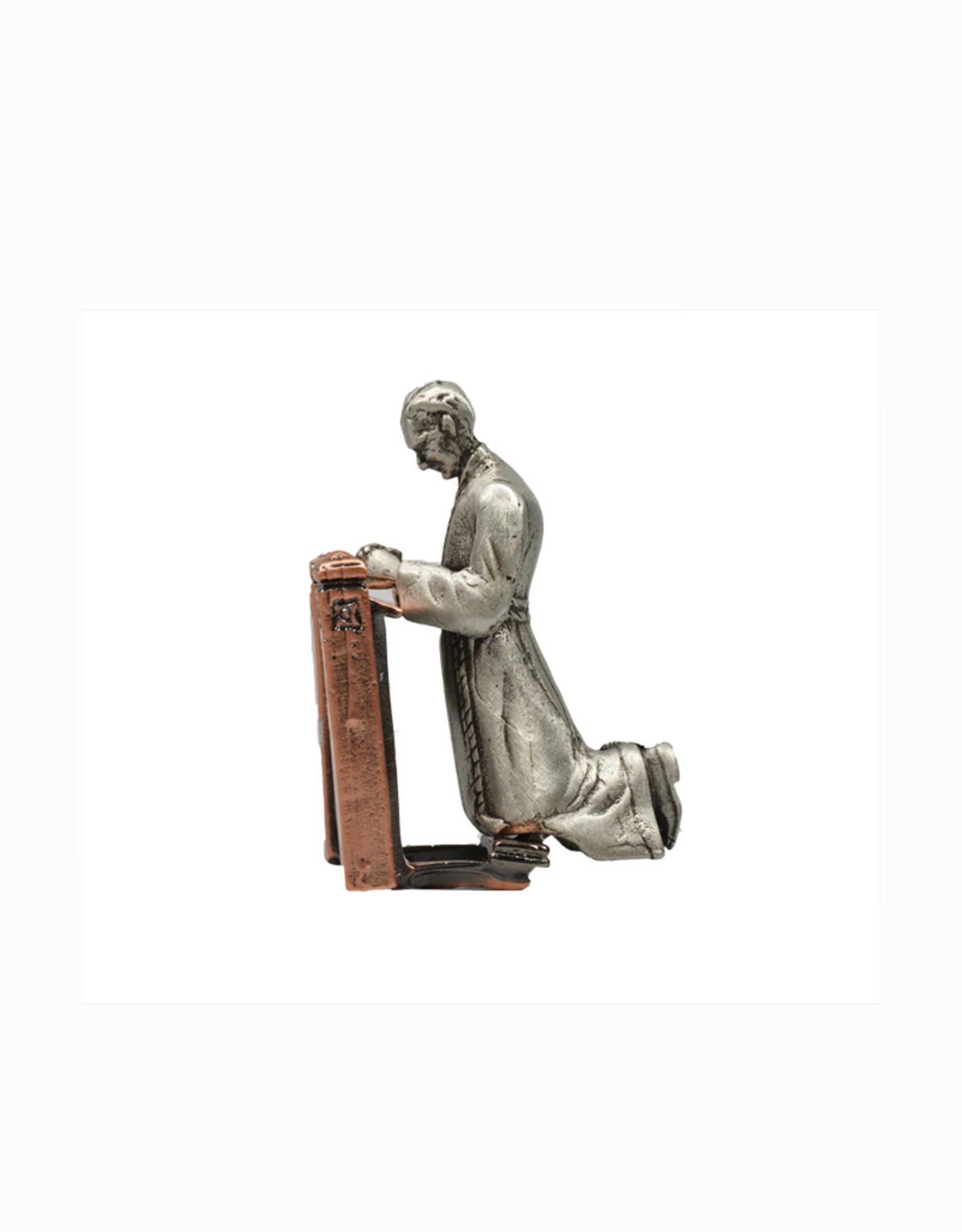 Statue Saint Brother André praying on kneeler