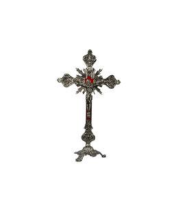 Crucifix en laiton fond velours rouge, sur sa base