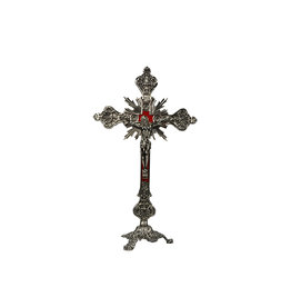 Crucifix en laiton fond velours rouge, sur sa base