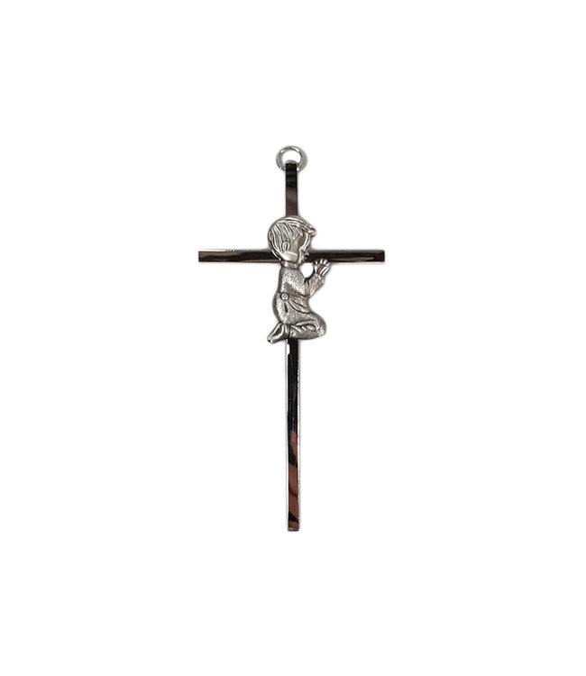 Silver colored metal baptism cross with praying boy