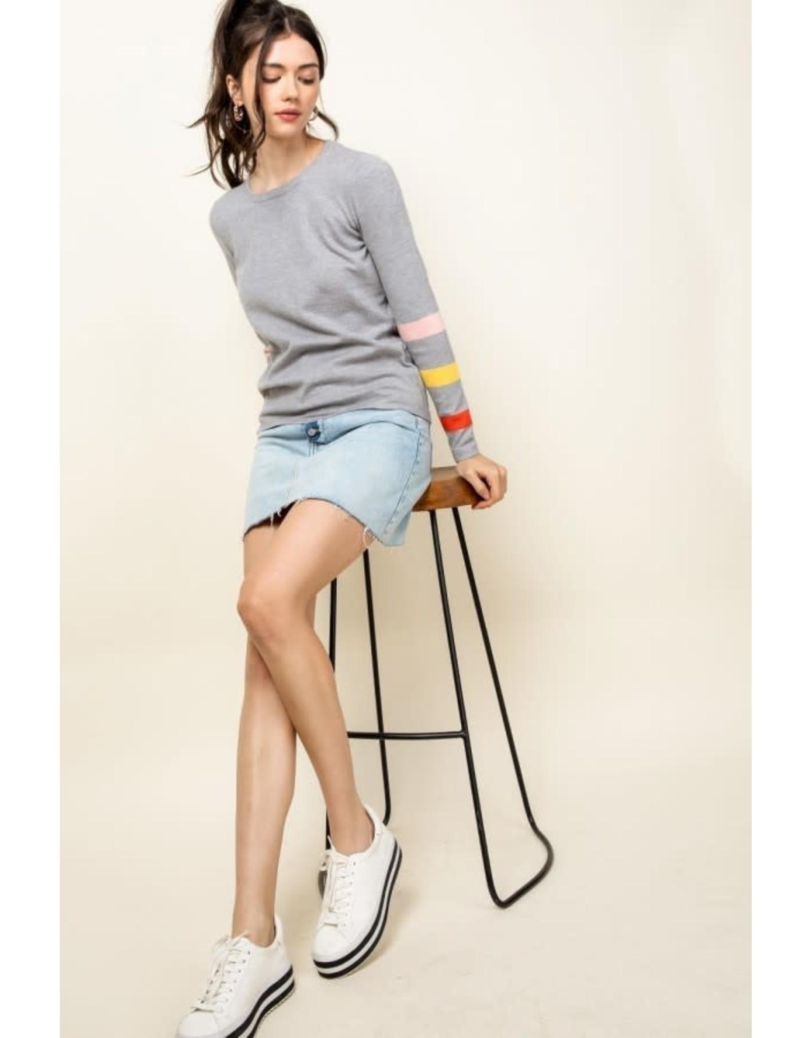 Regina - Ribbed sweater with striped cuffs