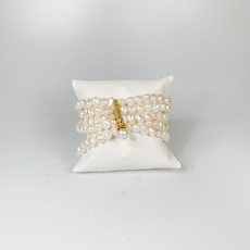 Catherine Canino Catherine Canino freshwater pearl stretchy cluster with golden tie and pearl button clasp