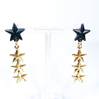 Tova Gold Plated brass base metal Star dangle earring