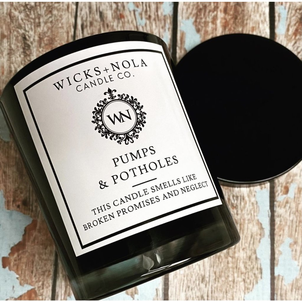 Wicks + Nola Candle Co. 11 oz Drainage Pumps and Potholes Black Candle