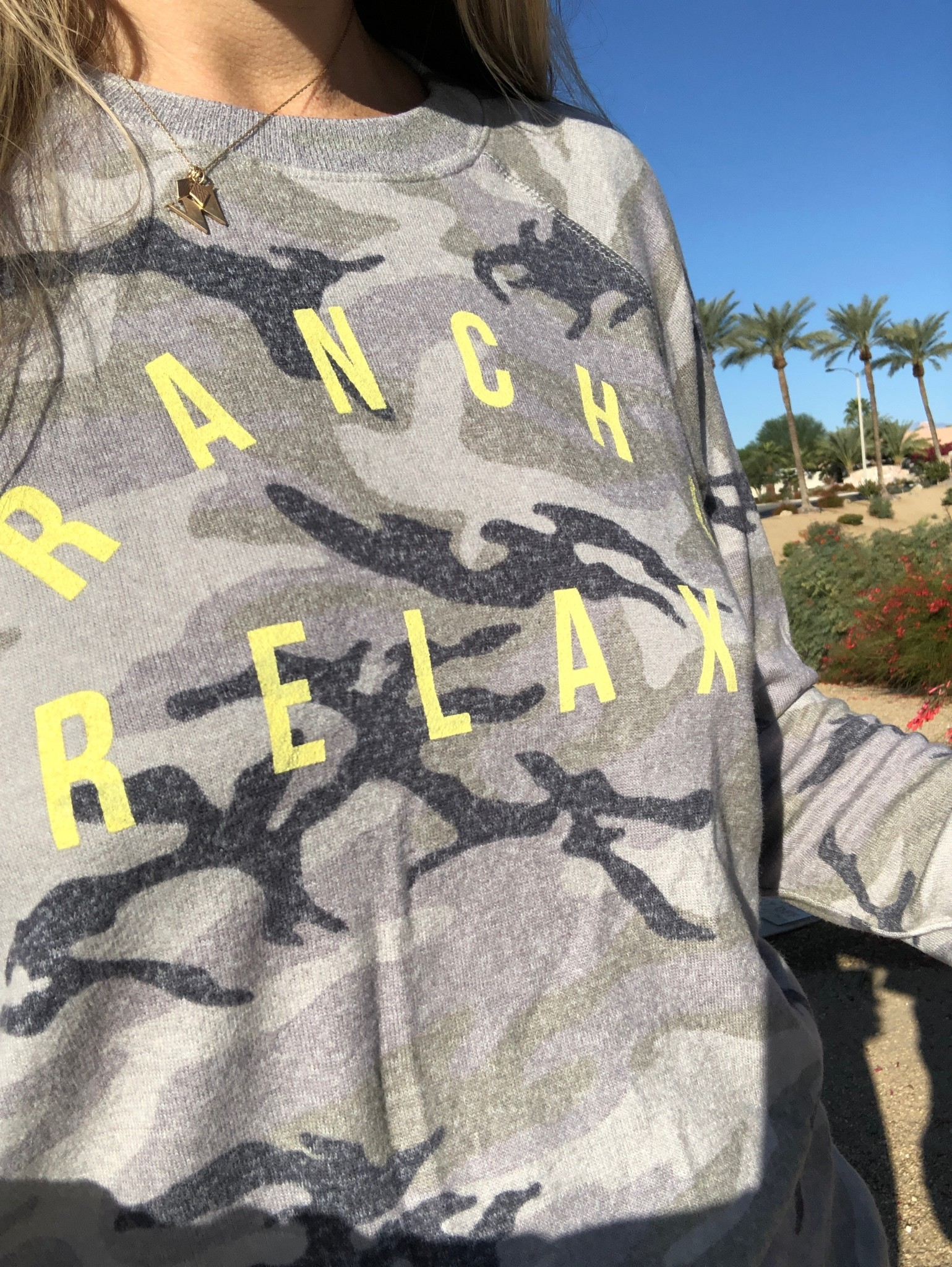 The soon to be iconic Rancho Relaxo camo pullover. LOVE the neon letters!