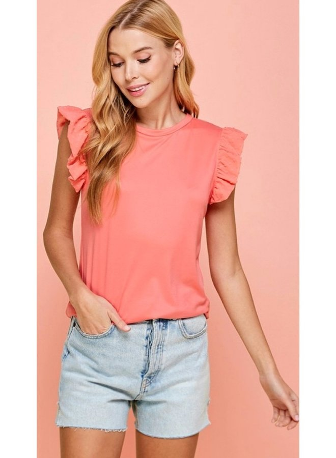 solid top with ruffle detail