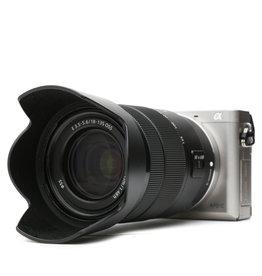 Sony Sony Alpha a6000 Mirrorless Digital Camera (Silver) with 18-135mm OSS Lens (Black)