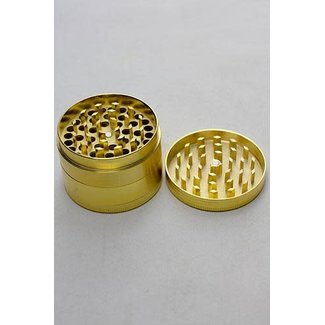 Infyniti Infyniti Gold 4 parts Tobacco metal grinder in a display case
