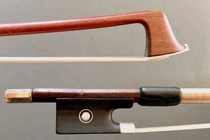 Old German Pernambuco violin bow, silver-mounted with replaced adjuster