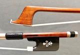 Arcos Brasil Arcos Brasil cello bow: horn & silver frog, with pearl fleur-de-lis inlay.