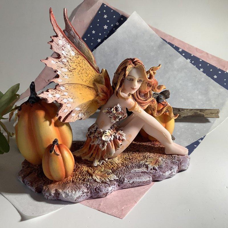 Autumn Fairybwith Pumpkins