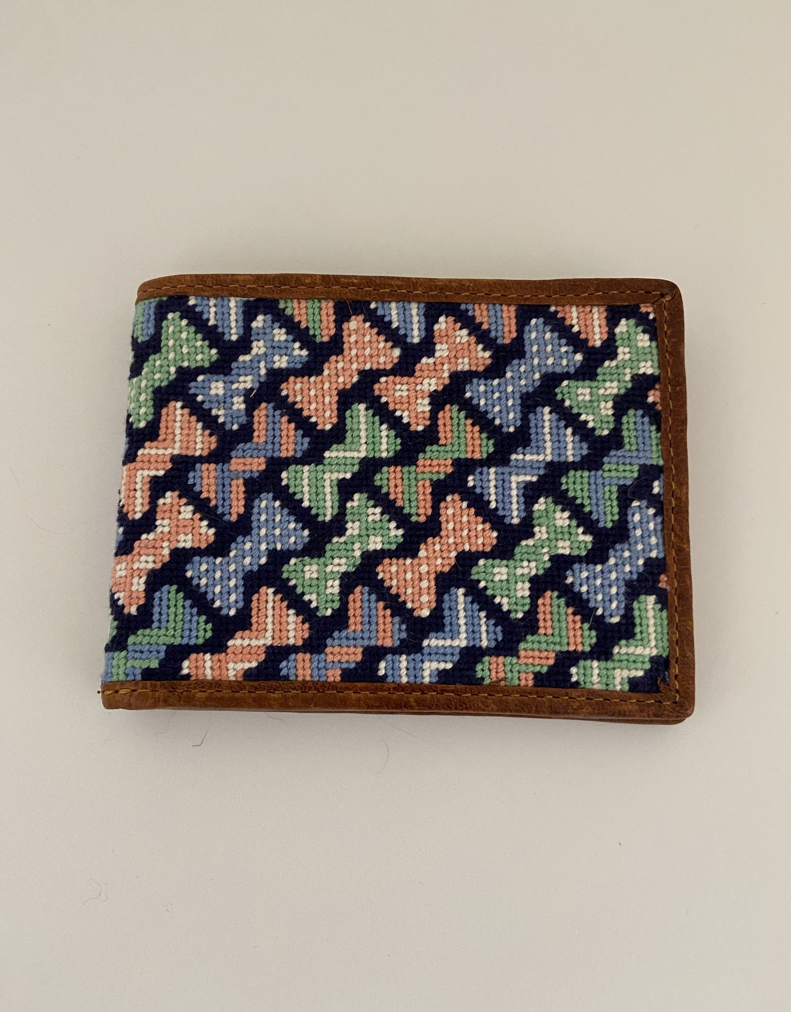 Gifts Needlepoint wallets are finished with English Bull hides, tanned in Italy.
