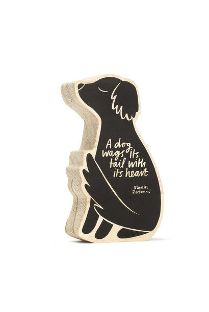 a dog wags it's tail with it's heart wood sign