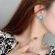 Blue Flower Yellow Center Clip-On Earring