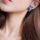Flower with Long String Clip On Earring