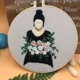Girl in Black with White and Pink Roses Embroidery