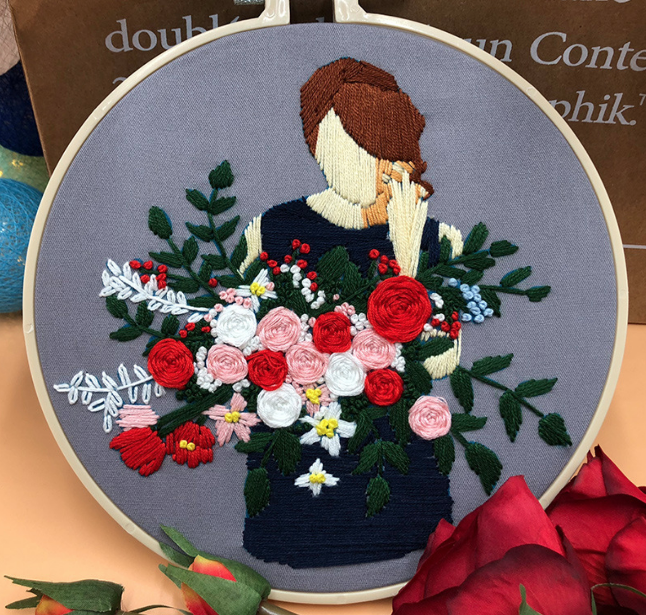 Pink/Red/White Bouquet held by Brunette Woman on Grey Embroidery
