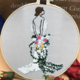 Brunette in Wedding Dress Embroidery