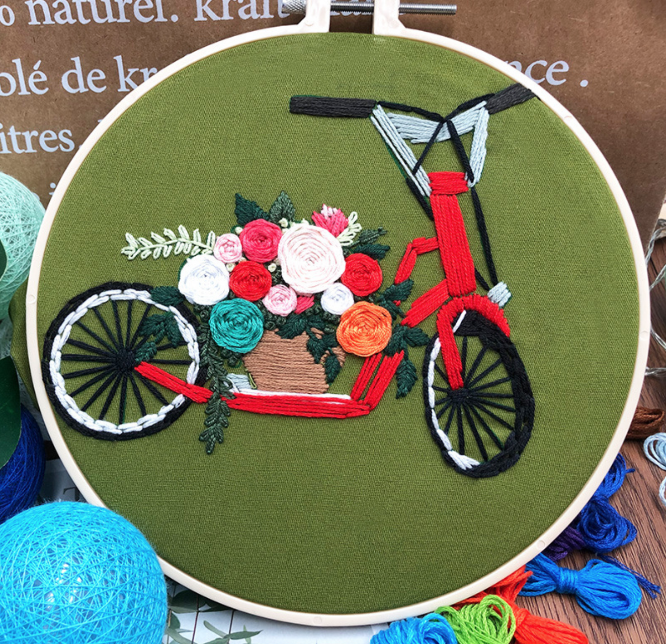 Red Electric Scooter on Green Embroidery