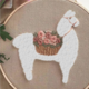 Fuzzy Llama with Flowers on Brown Embroidery