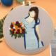Blue Dress Brunette with Red and Orange Bouquet on Grey Embroidery
