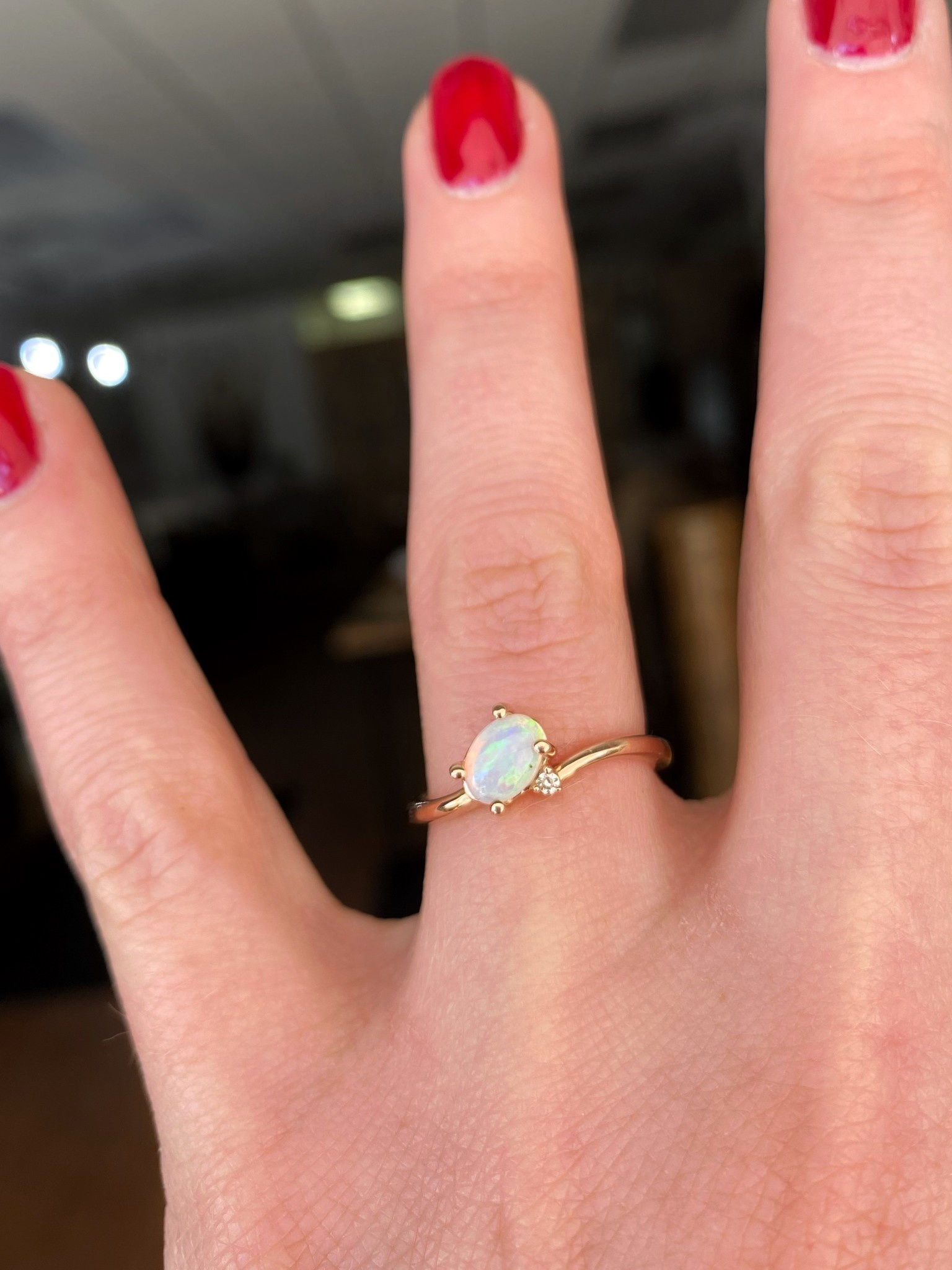 Opal ring with diamond accent in rose gold