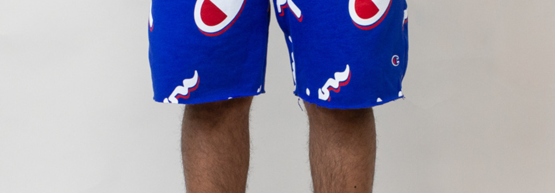 Champion Cut-Off Shorts All Over Logo - Blue