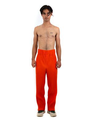 HOMME PLISSÉ ISSEY MIYAKE Italian Orange Trousers