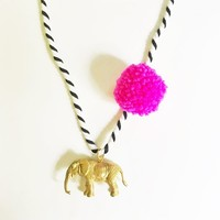 The Trendy Tot Pompom Necklace in Pink -