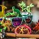 OG goodr - Electric Dinotopia Carnival