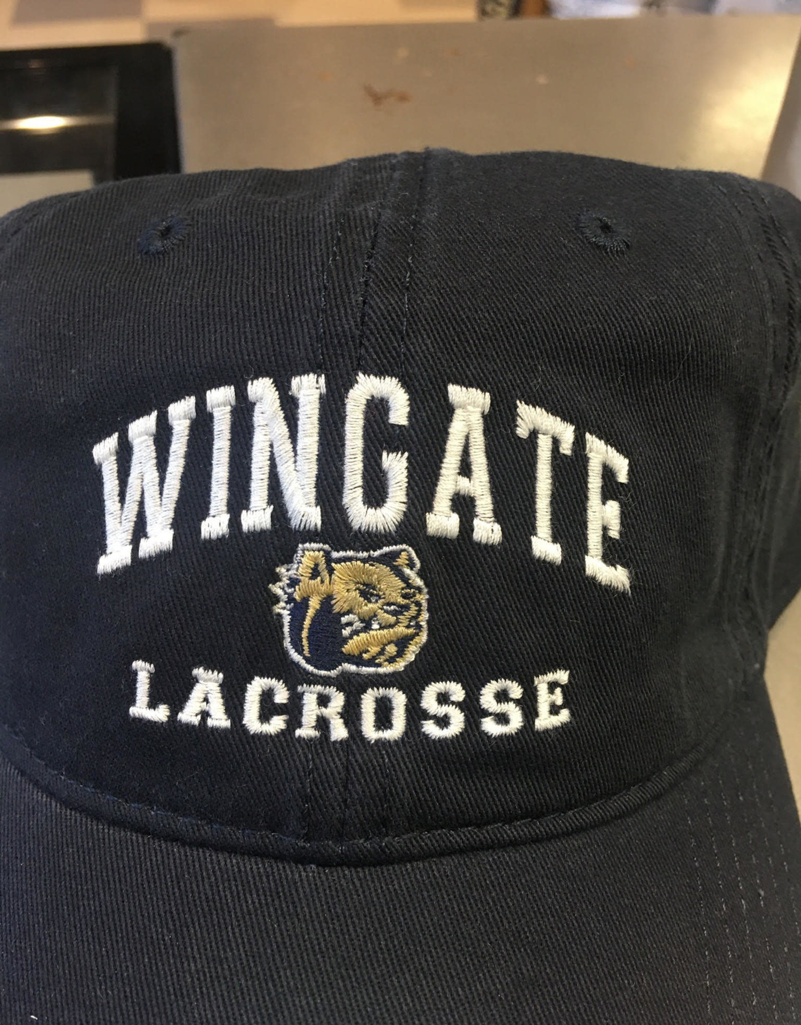 The Game Navy Wingate Dog Head Lacrosse Unstructured Adjustable Hat