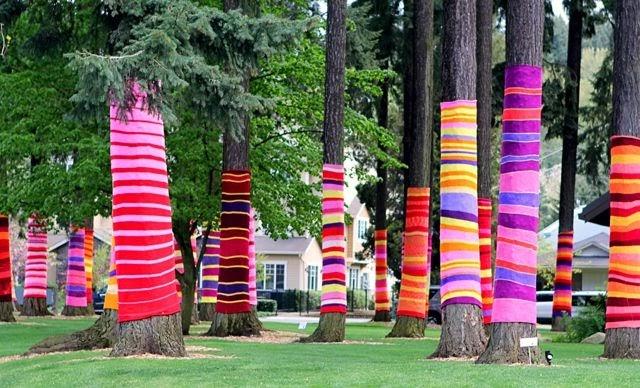 Yarn covered tree trunks