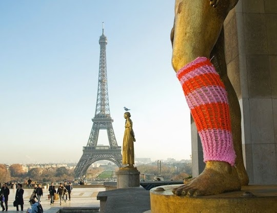 Yarn sock covering the leg of statue
