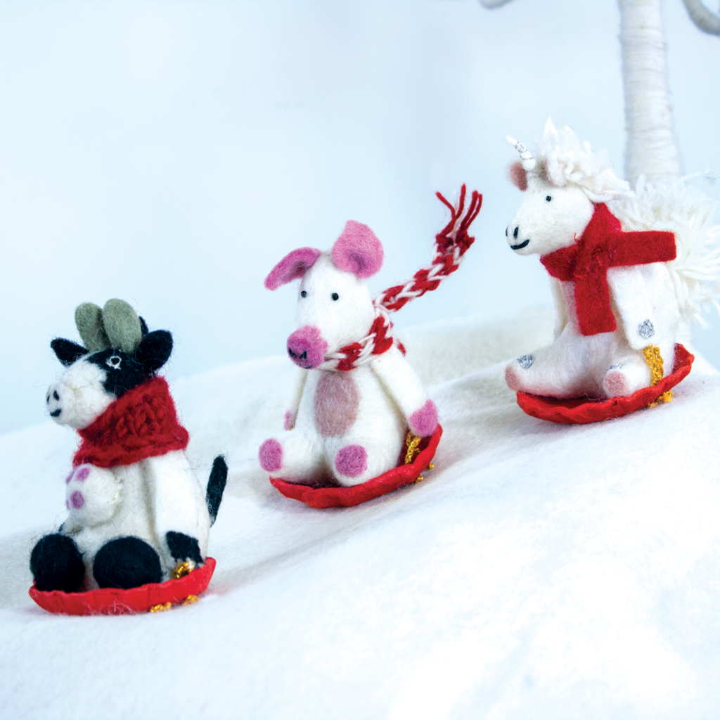 DZI Handmade Sledding Bessie the Cow Ornament