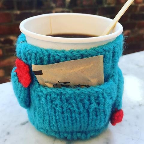coffee cup in wool cup cozy