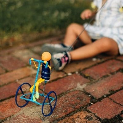 Ten Thousand Villages Galimoto Short Hair Cyclist