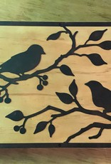 Metal birds on wood