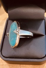 Opalized Wood wrapped in 14K rose gold accented with micro pearls in a Sterling Silver band Size 7