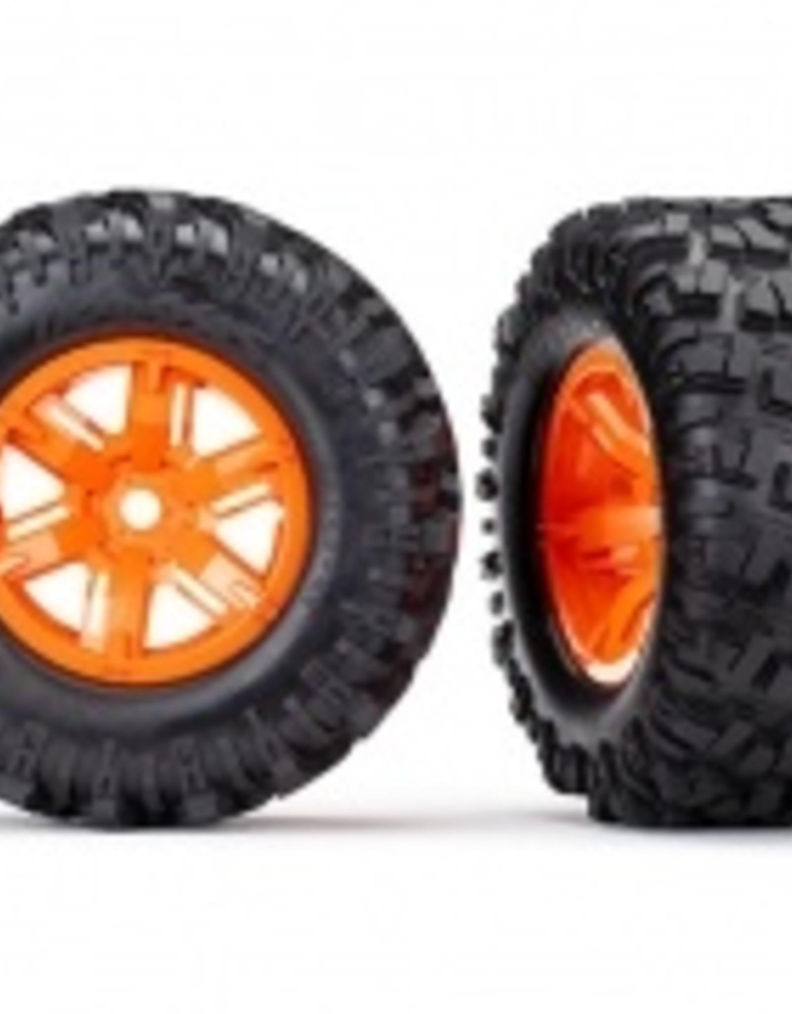 Traxxas Traxxas X-Maxx Tires & wheels, assembled, glued (X-Maxx® orange wheels, Maxx® AT tires, foam inserts) (left & right) (2)
