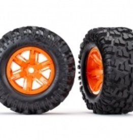 Traxxas Traxxas X-Maxx Tires & wheels, assembled, glued (X-Maxx® orange wheels, Maxx® AT tires, foam inserts) (left & right) (2)