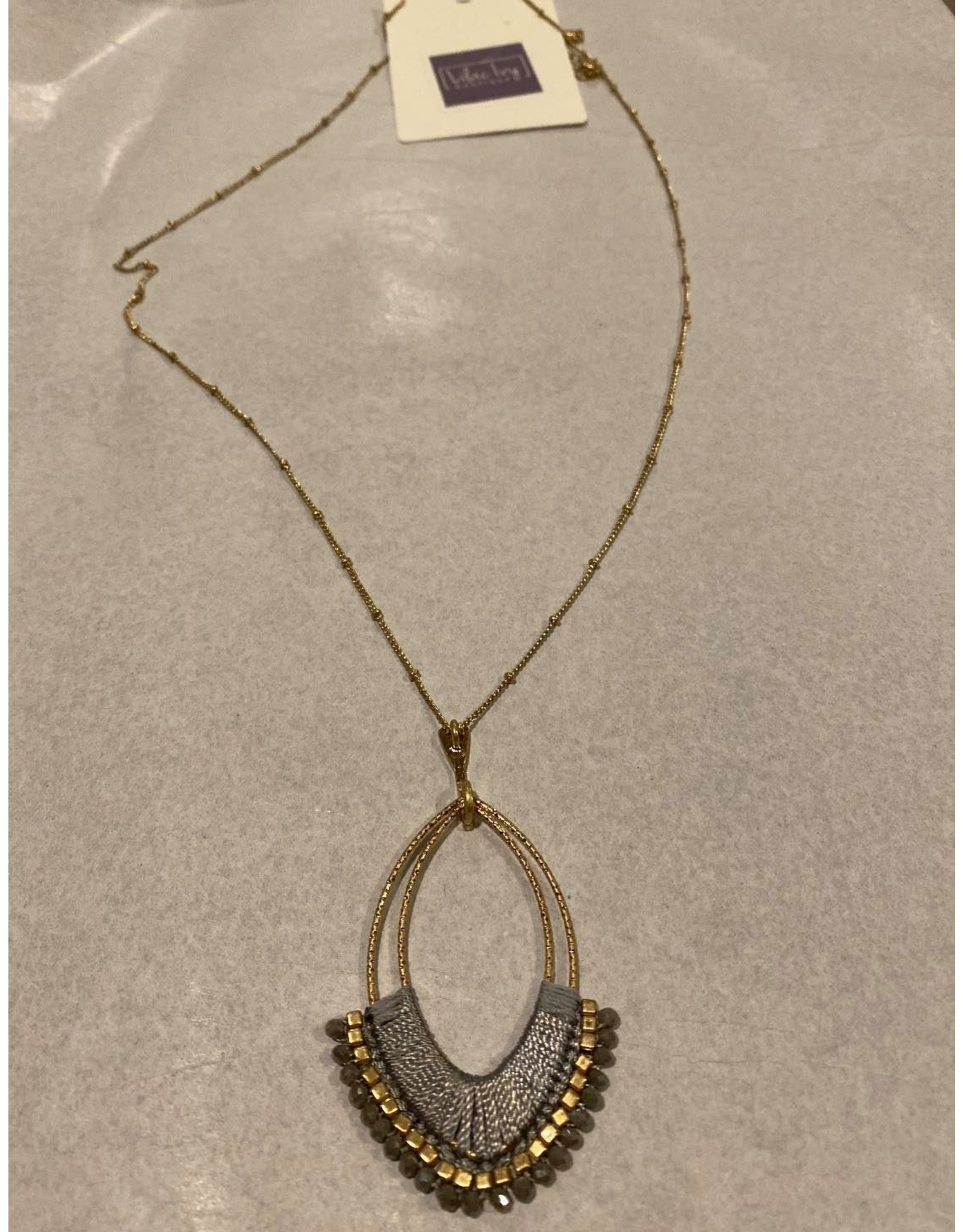 What's Hot Gold with gray wrapped teardrop and crystal