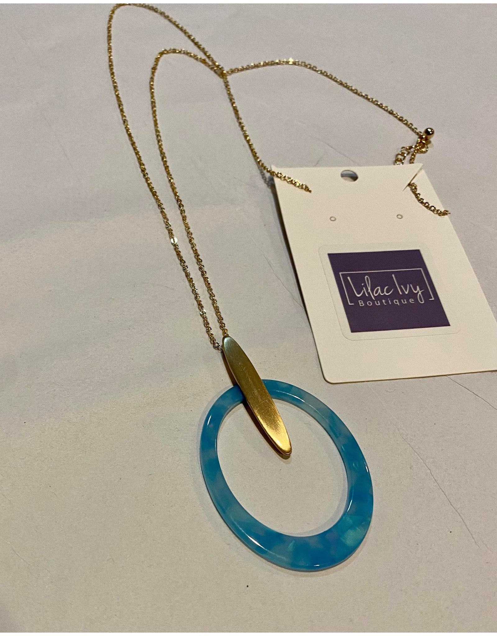 What's Hot Teal acrylic open circle with gold accent necklace