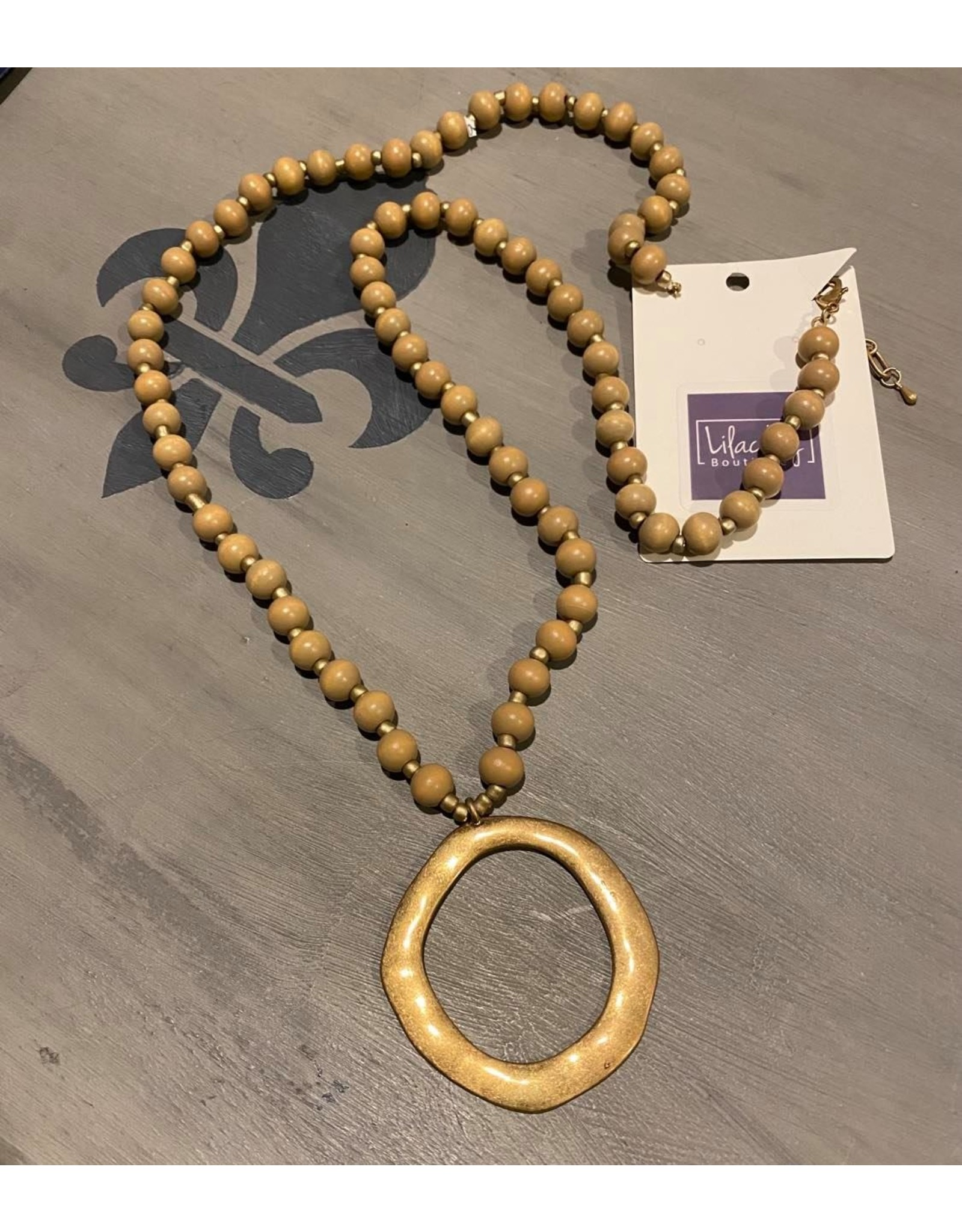 What's Hot Brown wood beaded necklace wlith gold circle pendant