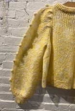 Rodebjer: Light yellow sweater with pom poms