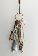 SEEDS SEEDS WISH NECKLACE ON BROWN LEATHER