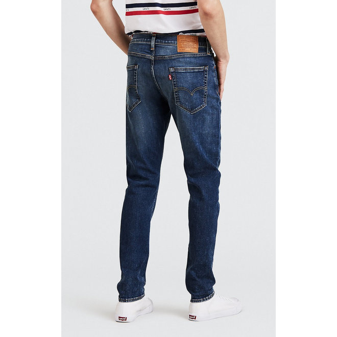 512 Slim Taper Jeans in Revolt Adv