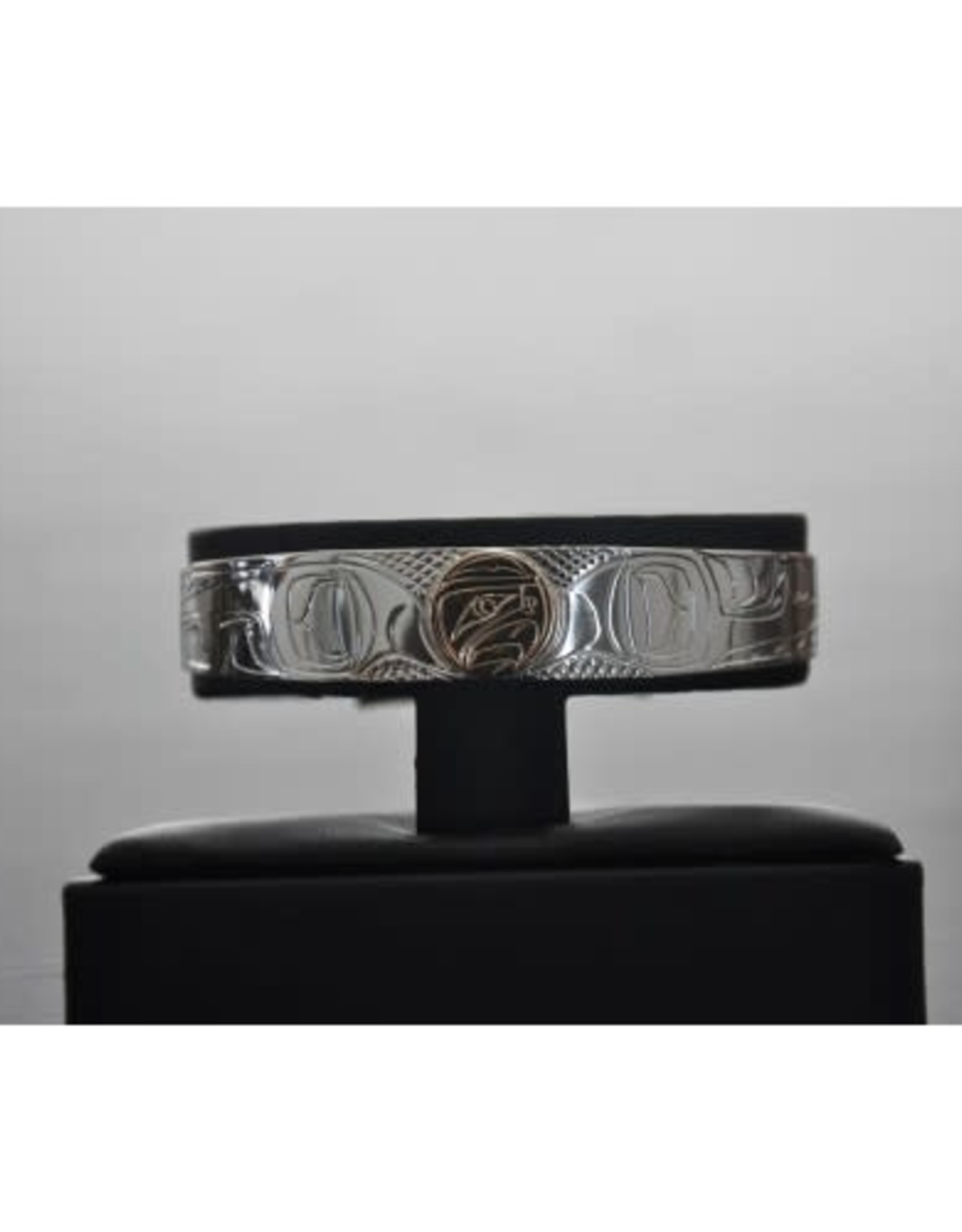 """1/2"""" Wide hand carved silver Bracelet With a 14Kt Gold Disc In The Eagle Design.  Handmade by Nancy Dawson"""